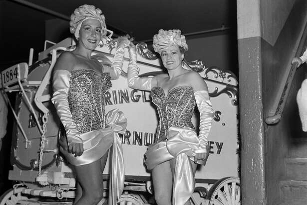 Entertainers pose backstage during Ringling Bros. and Barnum & Bailey Circus in New York, New York. (Photo by Earl Leaf/Michael Ochs Archives/Getty Images)