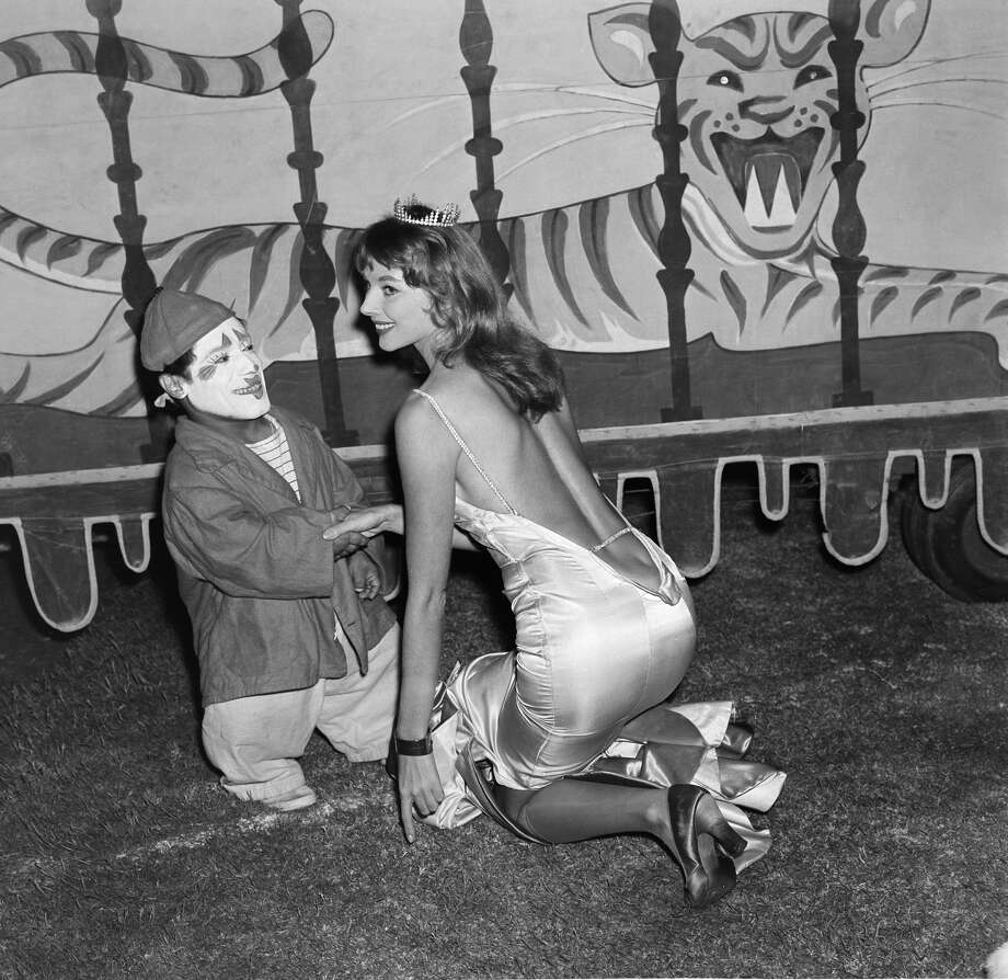 Actress Vikki Dougan poses with a clown as the Ringling Bros. and Barnum & Bailey Circus comes to  Los Angeles,California.(Photo by Earl Leaf/Michael Ochs Archives/Getty Images) Photo: Michael Ochs Archives/Getty Images