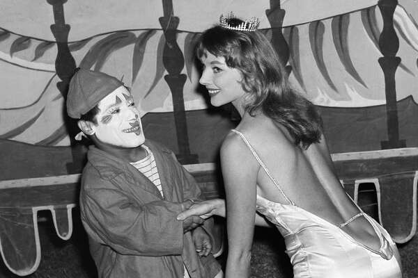 Actress Vikki Dougan poses with a clown as the Ringling Bros. and Barnum & Bailey Circus comes to  Los Angeles,California.(Photo by Earl Leaf/Michael Ochs Archives/Getty Images)