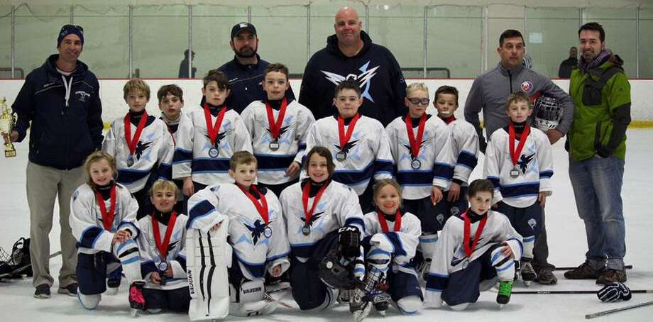 The Northwestern Icehawks Mite Travel hockey team recently came in runner up in their division at the Jingle Bell Skate tournament in Marlborough, Mass. Pictured above, from left to right, are Merritt Tessier, Andrew Antonelli, Cameron Packett, Ryder Press, Whitney Rousseau and Kate Wagner; second row, Gunner Ough, Thomas Heslin, Shea Mulhern, Will Neeb, Ryley Boisvert, Jonathan DeRoberts, Dylan Hilario and Dante Pruss; and in back, coaches Pat Boisvert, Pete Heslin, Chris Boisvert, Matt Pruss and Craig Ough. Missing from the photo is Derek Packett. Photo: Contributed Photo / Contributed Photo / The News-Times Contributed