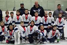 The Northwestern Icehawks Mite Travel hockey team recently came in runner up in their division at the Jingle Bell Skate tournament in Marlborough, Mass. Pictured above, from left to right, are Merritt Tessier, Andrew Antonelli, Cameron Packett, Ryder Press, Whitney Rousseau and Kate Wagner; second row, Gunner Ough, Thomas Heslin, Shea Mulhern, Will Neeb, Ryley Boisvert, Jonathan DeRoberts, Dylan Hilario and Dante Pruss; and in back, coaches Pat Boisvert, Pete Heslin, Chris Boisvert, Matt Pruss and Craig Ough. Missing from the photo is Derek Packett.