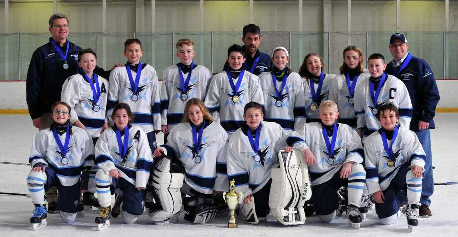 The Northwestern Icehawks Peewee B hockey team recently won the championship in their division at the Jingle Bell Skate tournament this past weekend in Marlborough, Mass. Pictured above, from left to right, are Charleigh Newman, Avery Trach, Jonas Veleas, Dino Capilupi, Ronan McKay and Bobby Labonia; second row, Connor Ross, Thomas Vailionis, Elliott Schemm, Graham Mitchell, Amanda Quinn, Morgan Gallagher, Peyton Nash and Blake Stephens; and in back, coaches Tom Vailionis, George Trach and Ron Stephens. Photo: Contributed Photo / Contributed Photo / The News-Times Contributed