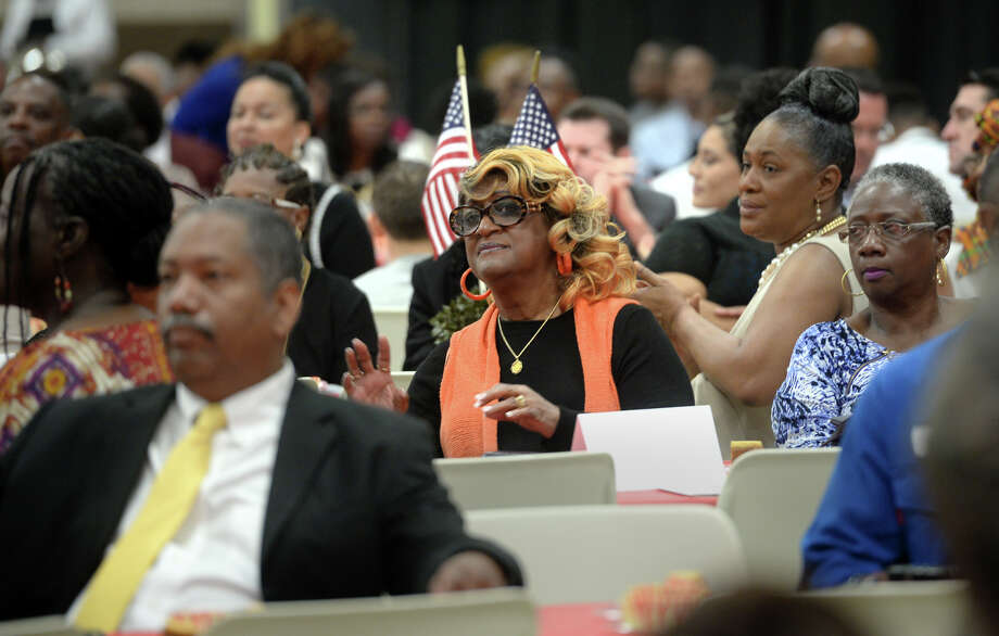 Guests sing and applaud during Port Arthur's Martin Luther King brunch on Monday. The event hosted speakers, awards and entertainment focused around recognizing the former civil rights leader. Photo taken Monday, January 16, 1016  Guiseppe Barranco/The Enterprise Photo: Guiseppe Barranco, Photo Editor