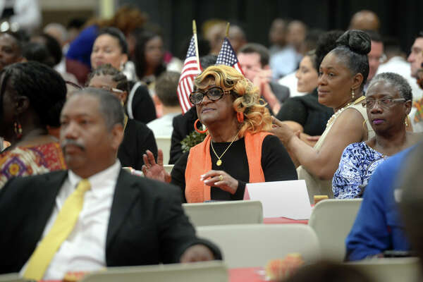 Guests sing and applaud during Port Arthur's Martin Luther King brunch on Monday. The event hosted speakers, awards and entertainment focused around recognizing the former civil rights leader. Photo taken Monday, January 16, 1016  Guiseppe Barranco/The Enterprise