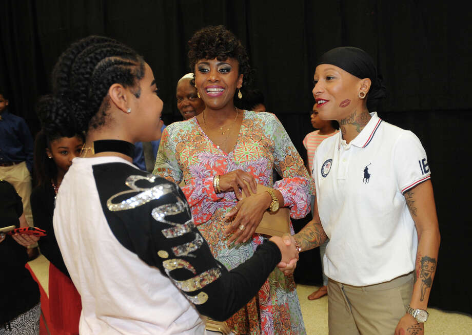 Olympic competitor and Port Arthur native Inika McPherson talks Monday to Tiffany Hamilton, center, and Tracey Young during the city's Martin Luther King Jr. Brunch. The event hosted speakers, awards and entertainment focused around recognizing the former civil rights leader. Photo taken Monday, January 16, 2017 Guiseppe Barranco/The Enterprise Photo: Guiseppe Barranco, Photo Editor