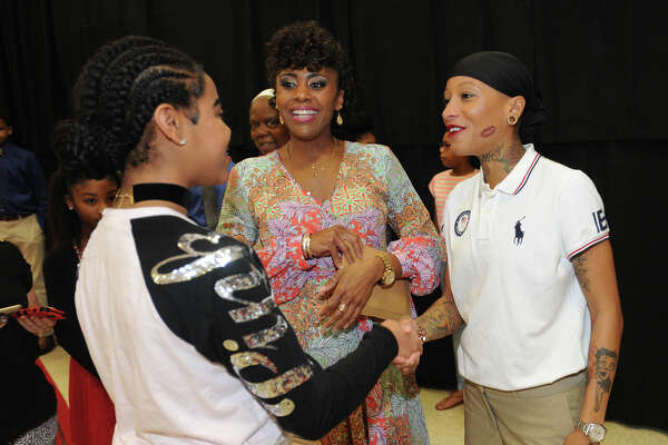 Olympic competitor and Port Arthur native Inika McPherson talks Monday to Tiffany Hamilton, center, and Tracey Young during the city's Martin Luther King Jr. Brunch. The event hosted speakers, awards and entertainment focused around recognizing the former civil rights leader. Photo taken Monday, January 16, 2017 Guiseppe Barranco/The Enterprise
