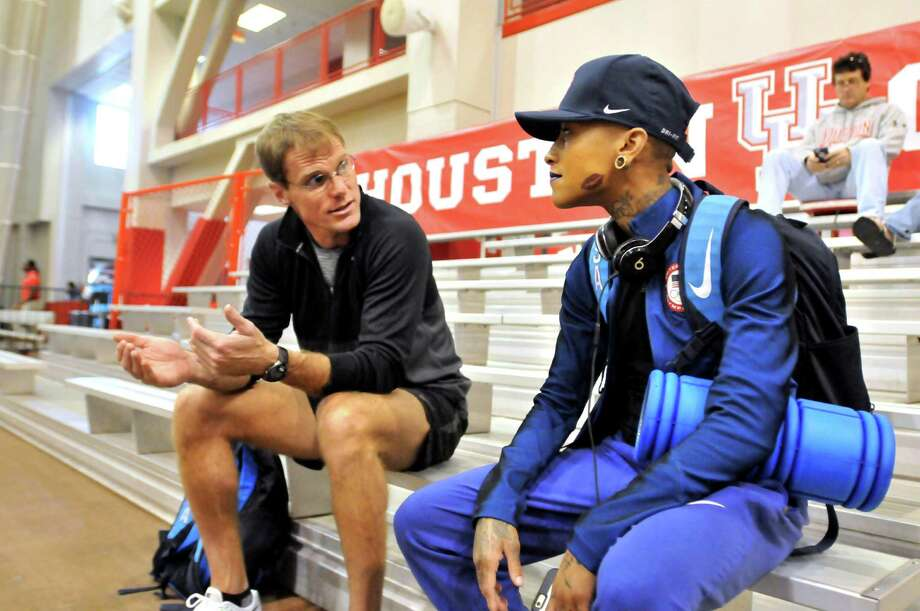 Port Arthur native and Rio Olympian Inika McPherson listens as Pat Pyle, a former coach, tells her what he saw of the three high jumps she took Friday during the University of Houston's Leonard Hilton Invitational. McPherson attempted a height of 5 feet 10 inches (1.77m), trying a new technique with a 10-step approach. McPherson attempted a height of 5 feet 10 inches (1.77m), trying a new technique with a 10-step approach. McPherson will be honored on Monday during The Martin Luther King Jr. Support Group of Southeast Texas' 31st annual scholarship brunch and celebration. (Mike Tobias/The Enteprise) (Mike Tobias/The Enteprise) Photo: Mike Tobias/The Enteprise