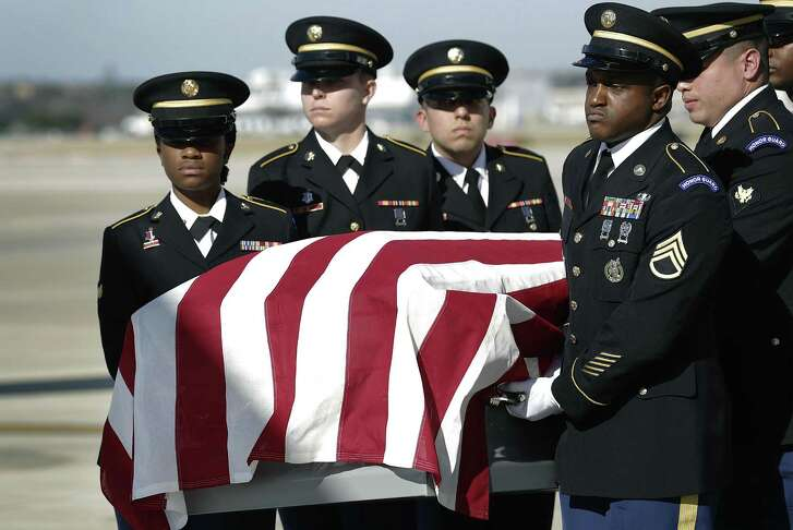 Members of the Ft. Sam Houston Militarly Honor Guard the casket containing the remains of Korean War POW/MIA Luis Patlan Torres on the tarmac at San Antonio International on Tuesday, Jan. 10, 2017.  Torres's remains had been missing for six decades.