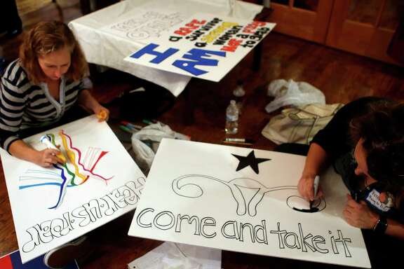 Women gather to make posters for the Houston Women's March on Washington on Sunday, Jan. 15, 2017, in a community organization building in the Heights. People made signs to carry both at a local march in downtown Houston and at the national march in Washington, D.C.(Annie Mulligan / Freelance)