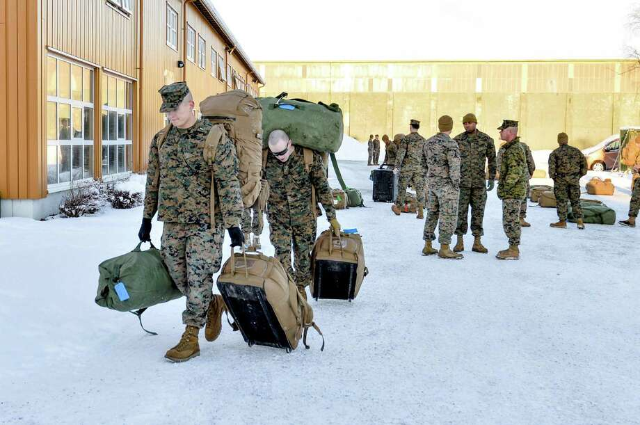 US Marines walk after landing on January 16, 2017 in Stordal, Norway.   Around 300 US Marines have landed in Norway. This is the first time that foreign troops have been allowed to be stationed here since World War Two.  / AFP PHOTO / NTB Scanpix / Ned ALLEY / Norway OUTNED ALLEY/AFP/Getty Images Photo: NED ALLEY, Stringer / AFP/Getty Images / AFP
