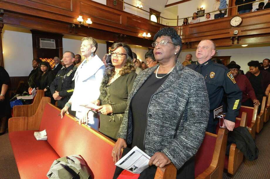 "Recognized for outstanding and invaluable service to youth and education, Serving All Vessels Equally, Inc. (SAVE) honorees, Dr. Lynne Moore of Norwalk Public Schools, Officer Cesar Ramirez, of the Norwalk Police Department, Jackie Roberson, of Carver Center, and Rosa Murray, former member of Norwalk Board of Education, sing ""Lift Every Voice"" during a special Justice Sunday Observance at Canaan Institutional Baptist Church, on Sunday in Norwalk. Photo: Alex Von Kleydorff / Hearst Connecticut Media / Connecticut Post"