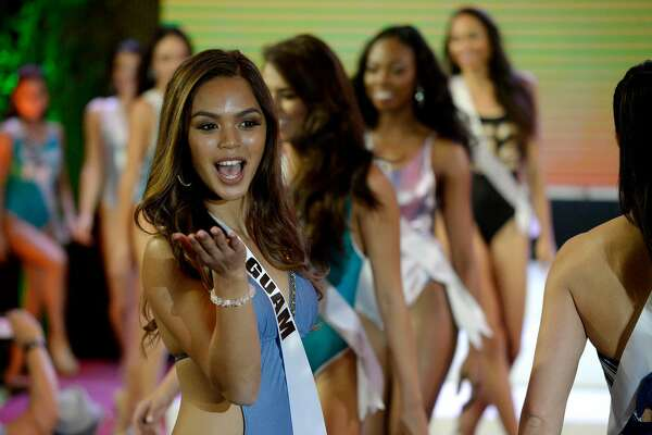 Miss Guam Muneka Joy Cruz Taisipic blows a kiss during a Miss Universe swimwear fashion show in Cebu City, central Philippines on January 17, 2017.