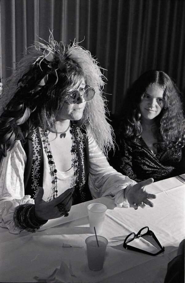 Singer Janis Joplin, left, speaks at a news conference before her high school reunion at the Goodhue Hotel. Her sister Laura Lee appears with her. Photo: David Nance, HC Staff / Houston Chronicle