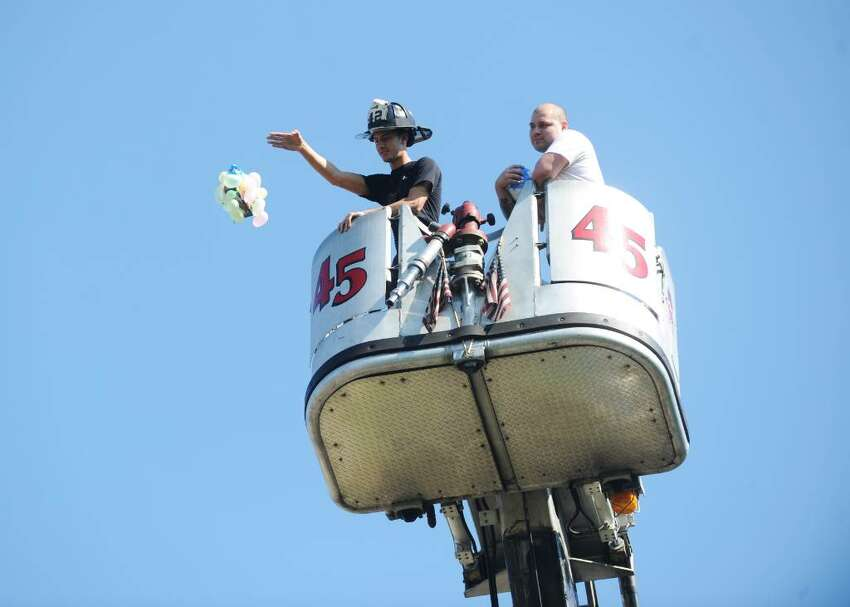 Matt Corsello, from the Belltown Firehouse, drops units from a ladder truck as eighth graders at Dolan Middle School participate in the finals of the Egg Drop with their hand made units in Stamford, Conn. on Wednesday May 26, 2010.