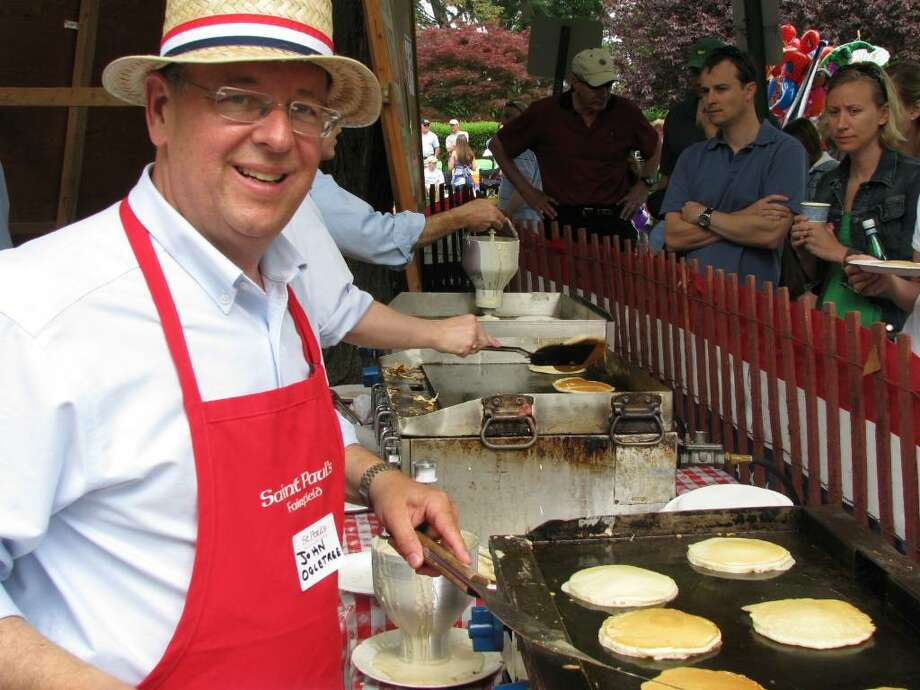 John Ogletree mans the pancake griddle at St. Paul's Pancake Breakfast on Memorial Day weekend in Fairfield last year. Photo: Contributed Photo, Contributed Photo / Rich Hagedus / Fairfield Citizen