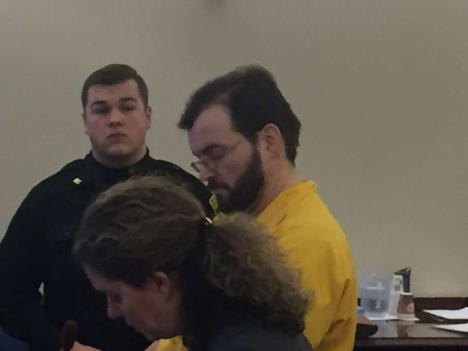 Derek Coppins, 41, in yellow, convicted in a baseball bat attack last year, was sentenced to the maximum sentence - 15 years in state prison - by Albany County Judge Peter Lynch.