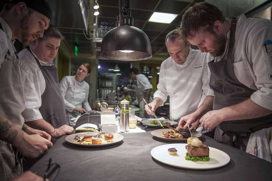 Dry Creek Kitchen executive chef Scottie Romano (left rear), Chef Charlie Palmer (right rear) line cook Michael Cochren (left front) and Sous chef Kyle Buchanan (right front) peeping plate during service, Saturday January, 07 2017 in Healdsburg, CA. (Peter DaSilva Special to the Chronicle) Photo: Peter DaSilva