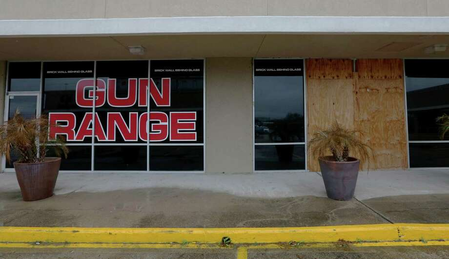 Plywood boards cover the outside of Full Armor Gun Range, whose owner said an attempted burglary early Tuesday was the 14th robbery in five years.  Photo: Yi-Chin Lee, Houston Chronicle / © 2017  Houston Chronicle