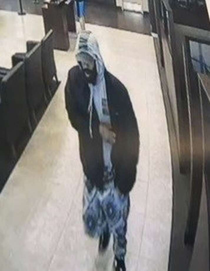 "Authorities are searching for man they say wore a fake ""James Harden-like"" beard during two bank robberies in recent weeks in the Houston area. (FBI)"