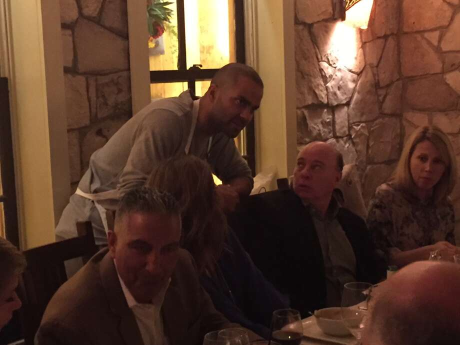 Spurs' coach Gregg Popovich and his team were servers for a night to raise money for the San Antonio Food Bank. Photo: Melissa Rohlin