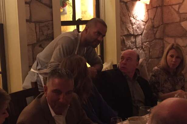 Spurs' coach Gregg Popovich and his team were servers for a night to raise money for the San Antonio Food Bank.