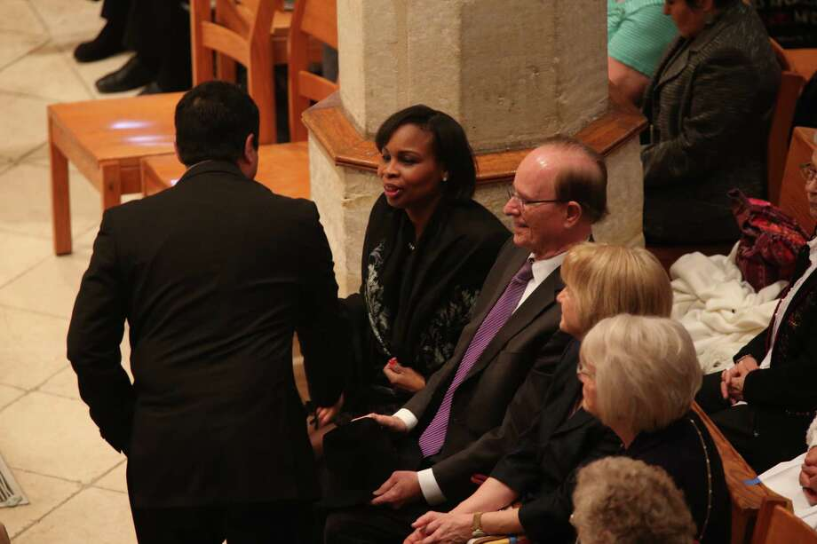 Mayor Ivy Taylor and Bexar County Judge Nelson Wolff arrive for funeral services for Archbishop emeritus Patrick Flores at Dan Fernando Cathedral, Tuesday, Jan. 17, 2017. Flores died last week. He was named Archbishop of the Diocese of San Antonio in 1979 until his retirement in 2004. Photo: Jerry Lara, San Antonio Express-News / 2017 San Antonio Express-News