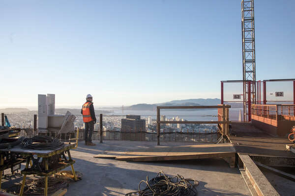 Assistant Construction Manager Spencer Barney takes in the view from the 62nd floor of the Salesforce Tower in San Francisco on January 13, 2017.