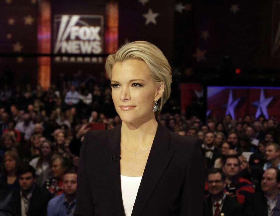 "FILE - In this Jan. 28, 2016 file photo, Moderator Megyn Kelly waits for the start of the Republican presidential primary debate in Des Moines, Iowa. Kelly's Fox News colleague, Sean Hannity, accused Kelly of backing Hillary Clinton on Wednesday, Oct. 5, 2016. The spat began Wednesday night on Kelly's program, when the anchor criticized both GOP presidential nominee Donald Trump and the Democratic candidate, Clinton, of avoiding tough media interviews. Kelly said Trump ""will go on Hannity and pretty much only Hannity."" Hannity responded on Twitter that Kelly ""clearly"" supports Clinton. (AP Photo/Chris Carlson, File) Photo: Chris Carlson / Associated Press / Copyright 2016 The Associated Press. All rights reserved. This material may not be published, broadcast, rewritten or redistribu"