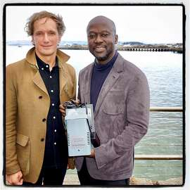 SFMOMA trustee Yves Behar (left) with FOG Innovators honoree architect Sir David Adjaye and his fog machine award. Jan 2017.