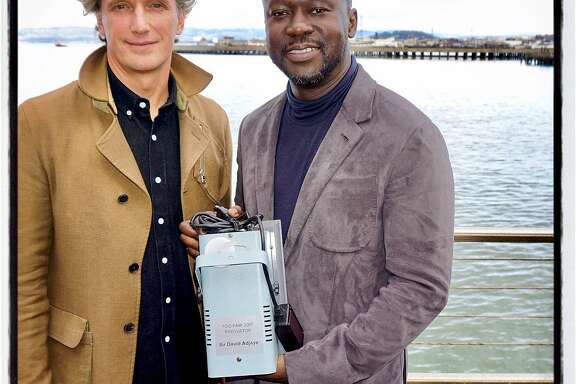 SFMOMA trustee Yves Behar (left) with FOG Innovators honoree architect Sir David Adjaye and his fog machine award. Jan 2017.