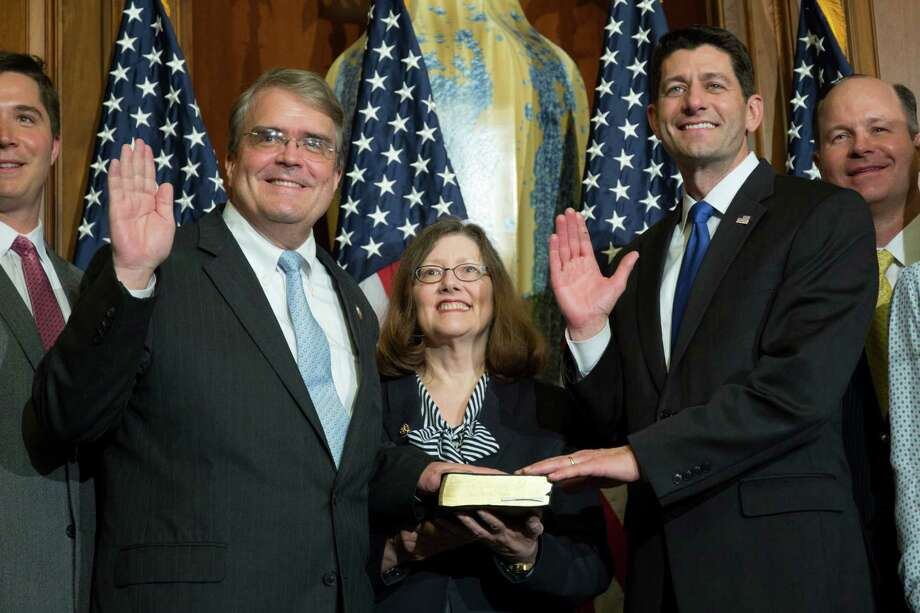 House Speaker Paul Ryan of Wis. administers the House oath of office to Rep. John Culberson, R-Texas, during a mock swearing in ceremony on Capitol Hill, Tuesday, Jan. 3, 2017, in Washington. (AP Photo/Zach Gibson) Photo: Zach Gibson, FRE / FR170359 AP