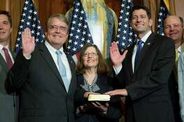 House Speaker Paul Ryan of Wis. administers the House oath of office to Rep. John Culberson, R-Texas, during a mock swearing in ceremony on Capitol Hill, Tuesday, Jan. 3, 2017, in Washington. (AP Photo/Zach Gibson)