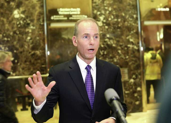 Boeing CEO Dennis Muilenburg speaks to the media at Trump Tower following a Tuesday meeting with Pesident-elect Donald Trump in New York City. )