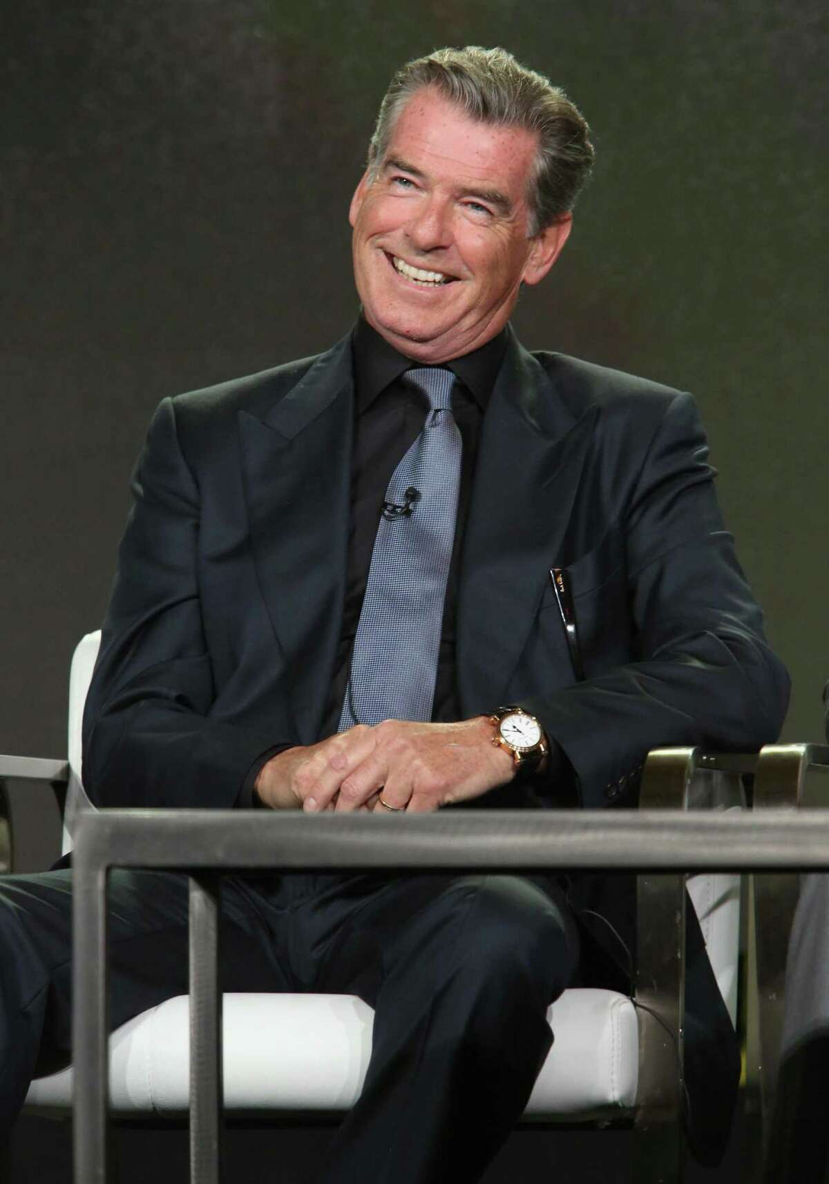 Handsome as ever, Brosnan speaks onstage during the AMC presentation of