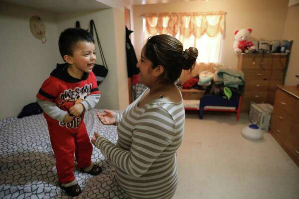 Abigail Alvarado, 26, plays with her son Antonio, 2, at their home in Chicago. Alvarado, who is undocumented, is nervous about the incoming Trump administration and a possible crackdown on undocumented workers like herself.