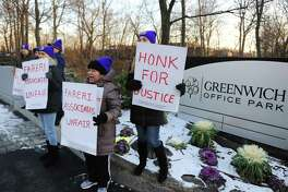 Indiana Y. Pena, left, of Port Chester, N.Y., Rosa Vasquez, center, of Stamford, and Mayra Maurad, of Port Chester, N.Y., hold up sign in protest outside Greenwich Office Park in Greenwich, Conn. Monday, Jan. 16, 2017. Former cleaners at Greenwich Office Park are demanding that Fareri Associates reinstate the 11 employees whom the building owners displaced from their jobs. On Nov. 4, the building owners ended their relationship with a cleaning contractor and did not rehire many of the workers left without jobs. The National Labor Relations Board is now investingating Fareri Associates for unfair labor practices.