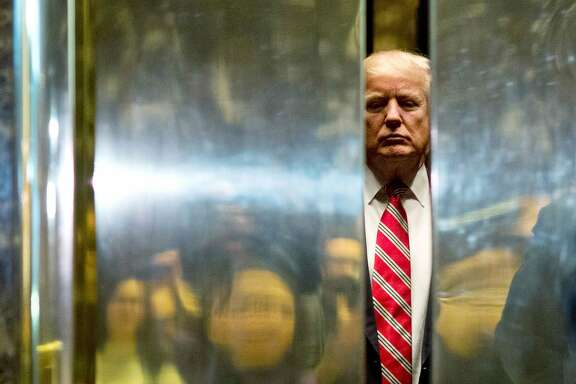US President-elect Donald Trump boards the elevator after escorting Martin Luther King III to the lobby after meetings at Trump Tower in New York City on January 16, 2017.  / AFP PHOTO / DOMINICK REUTERDOMINICK REUTER/AFP/Getty Images