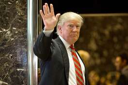 US President-elect Donald Trump waves toward the media after meeting Martin Luther King III at Trump Tower in New York City on January 16, 2017.  The eldest son of American civil rights icon Martin Luther King Jr. met with US President-elect Donald Trump on the national holiday observed in remembrance of his late father. / AFP PHOTO / DOMINICK REUTERDOMINICK REUTER/AFP/Getty Images