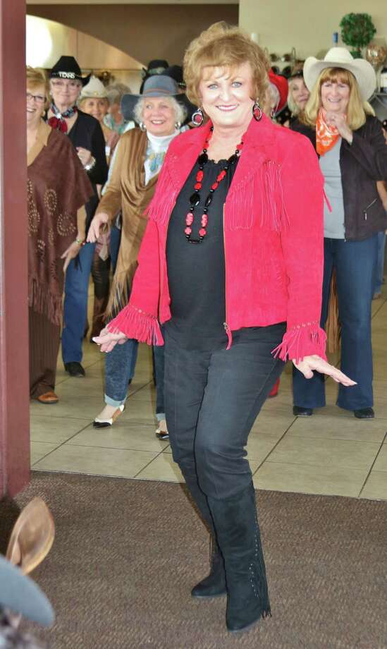 Kay Caffey leads a lindancing class for the Hi Neighbor Club-Kingwood. Photo: Courtesy Photo