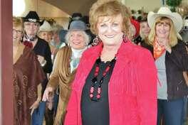 Kay Caffey leads a lindancing class for the Hi Neighbor Club-Kingwood.