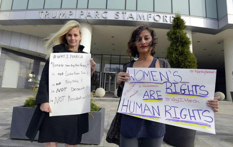 Lisa Boyne and Samantha Lobo are photograph in front of Trump Parc Stamford on Jan. 12, 2017. Boyne, along with the help of Lobo and several others, have organized a symposium for Jan. 21, 2017 in the auditorium at Stamford UCONN and will lead a march through the streets of Stamford, raising awareness to Women's issues and condemning President Elect Donald Trump. Photo: Matthew Brown / Hearst Connecticut Media / Stamford Advocate