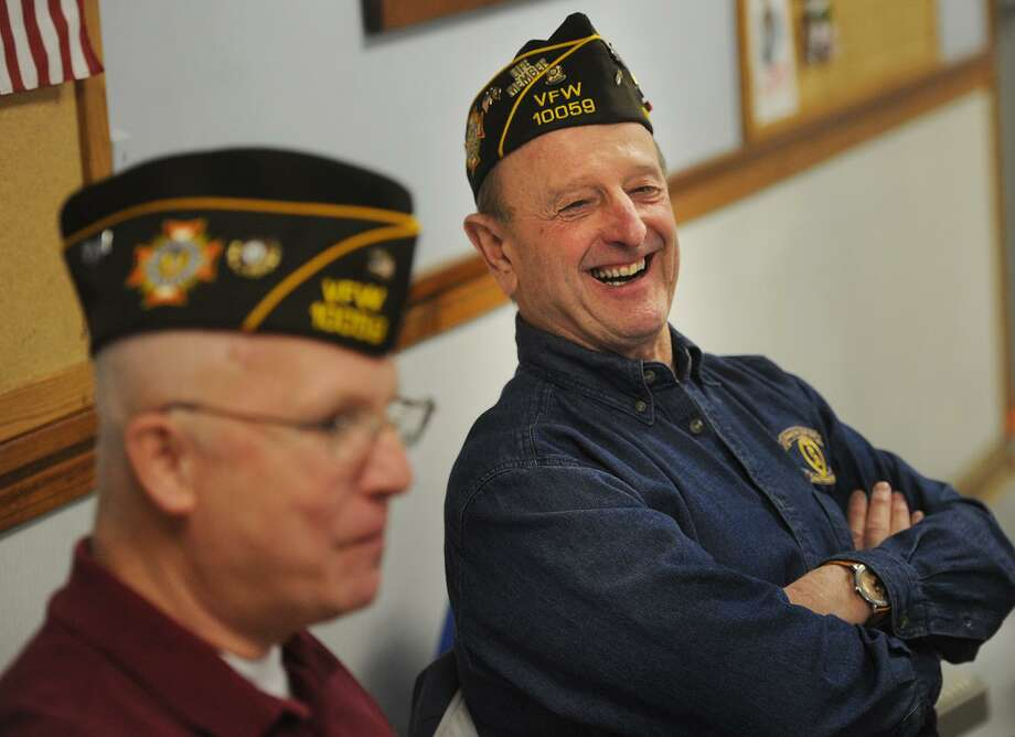 Trumbull VFW members John Gray, left, of Trumbull, and John Alberghini, of Monroe, have a laugh over a slice of pizza following the bi-monthly meeting of members at VFW Post 10059 in Trumbull, Conn. on Thursday, January 12, 2016. Because of declining membership, members said they need the town to pick up more of their monthly costs or the post will be forced to return their building to the town. Photo: Brian A. Pounds / Hearst Connecticut Media / Connecticut Post