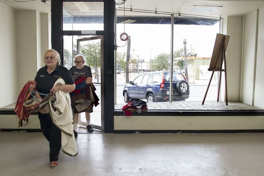 Diane and Rick Malone, two of Classic Theatre's founders, unload costumes in the theatre's new annex. Photo: Alma E. Hernandez / For The San Antonio Express News