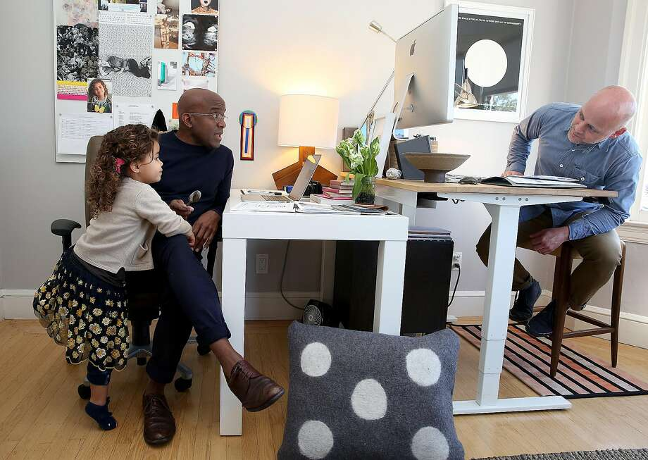 Designers Robbie McMillan and Marcus Keller with their daughter, Apple, in their AubreyMaxwell office at home. Photo: Liz Hafalia, The Chronicle