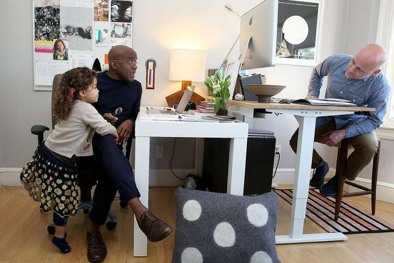 Designers Robbie McMillan and Marcus Keller with their daughter Apple in their AubreyMaxwell office at home on Monday, January 16, 2017 in San Francisco, Calif.