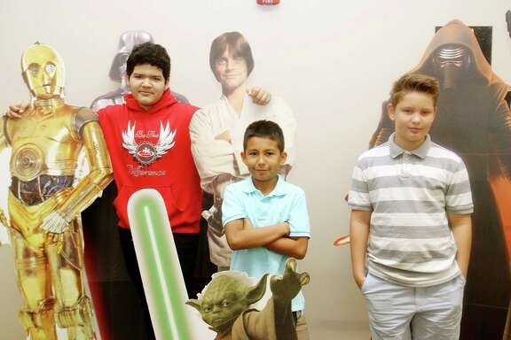 Nathan Gamino,,13, Geovanni Abrego ,11, and Cohan Perkins, 11, say they are excited about  BrazCon, a comic convention for youths scheduled for Jan. 28 at Rodeo Palms Junior High School in Manvel.