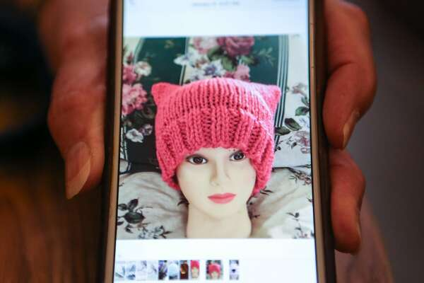 Beverly Edmonds displays an example of one of the hats she knit as part of the Pussyhat Project on Tuesday, January 17, 2017 in Benicia, Calif.