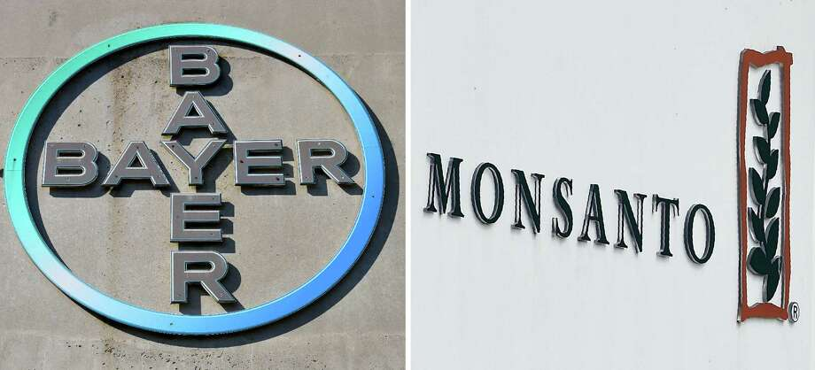 German chemicals giant Bayer will invest about $8 billion in the United States in agriculture research in conjunction with Monsanto, which it is purchasing, the companies said Tuesday. Photo: Photo Illustration By AFP /Getty Images / AFP or licensors