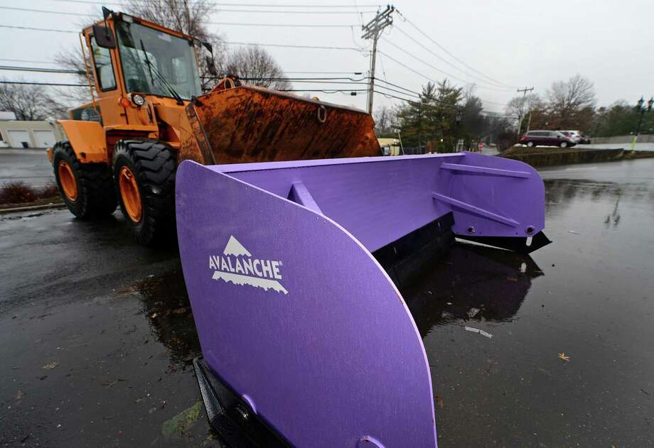 The front loader used to remove snow at the Super Stop and Shop Tuesday, Jan. 17, on Post Road East in Westport. The Norwalk Police Department dedicated the loader with a purple plow at Super Stop and Shop in honor of late Officer Tim Murphy, and other victims of pancreatic cancer. Photo: Erik Trautmann / Hearst Connecticut Media / Norwalk Hour