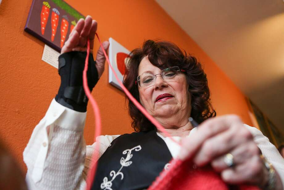 Beverly Edmonds works on finishing her remaining orders for friends and family as part of the Pussyhat Project on Tuesday, January 17, 2017 in Benicia, Calif. Edmonds has been knitting so much in the last few weeks to keep up with orders for the Pussycats that she has to now wear a wrist brace. Photo: Amy Osborne, Special To The Chronicle